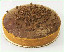 Round cake baked in pate sucree pastry crust and filled with chocolate ...
